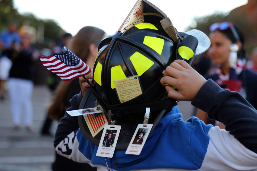 Xavier Alvarez, 11, decorated his father's fire helmet with the firefighters prayer, the American Flag, and photos of firefighters killed on Sept. 11, 2001.