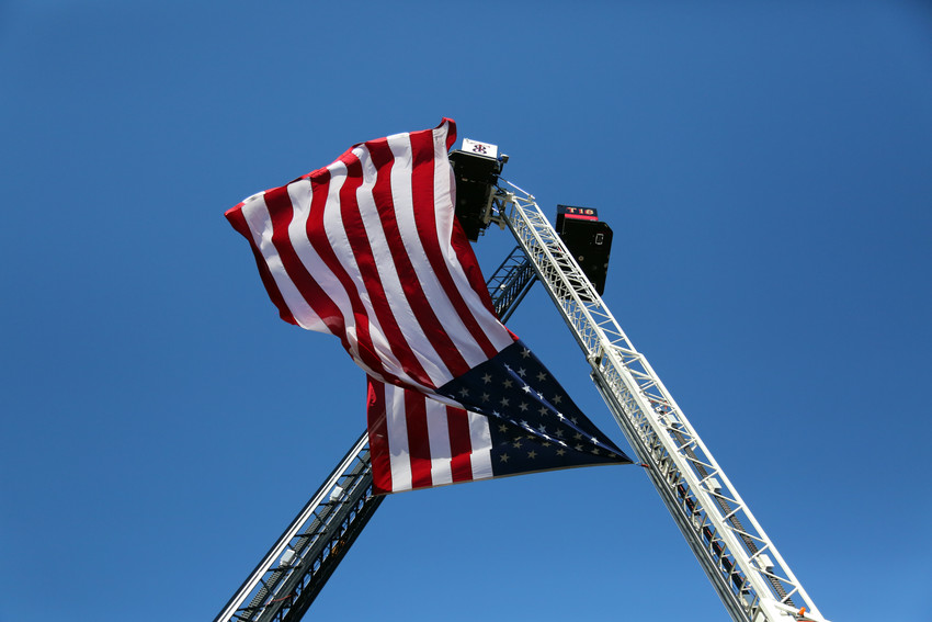 The American Flag flew high above as more than 2,300 first responders and community members gathered to remember the events of Sept. 11, 2001.