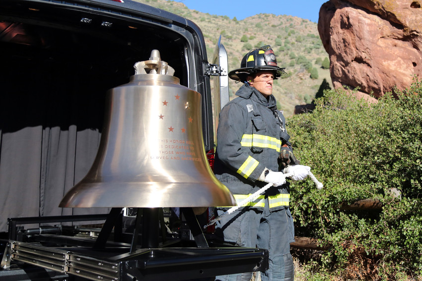 West Metro firefighter Brad Harmon rings the Honor Bell in honor of the lives lost on Sept. 11, 2001.