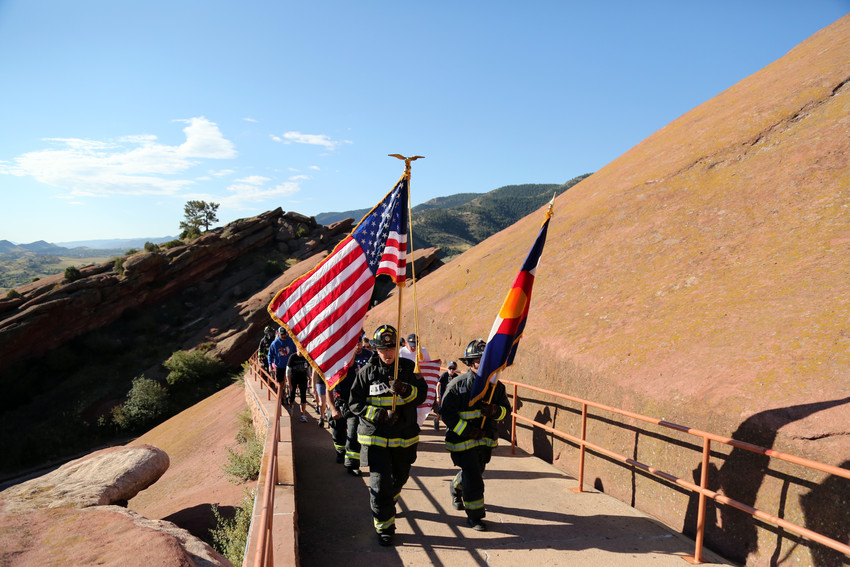 Members of West Metro Fire lead the 9/11 Stiar Climb at Red Rocks.
