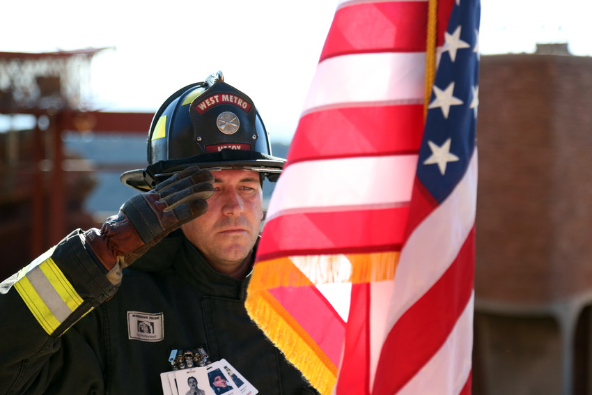 Tyler Hecox with West Metro Fire stands to salute the American Flag during the 9/11 Stair climb held at Red Rocks Sept. 11.