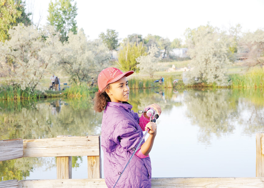 Eleven-year-old Dina Melendez of Thornton, gets ready to cast her line during the Fishing Derby of this year's Thornton Harvest Fest, held at Grandview Ponds on Sept. 8.