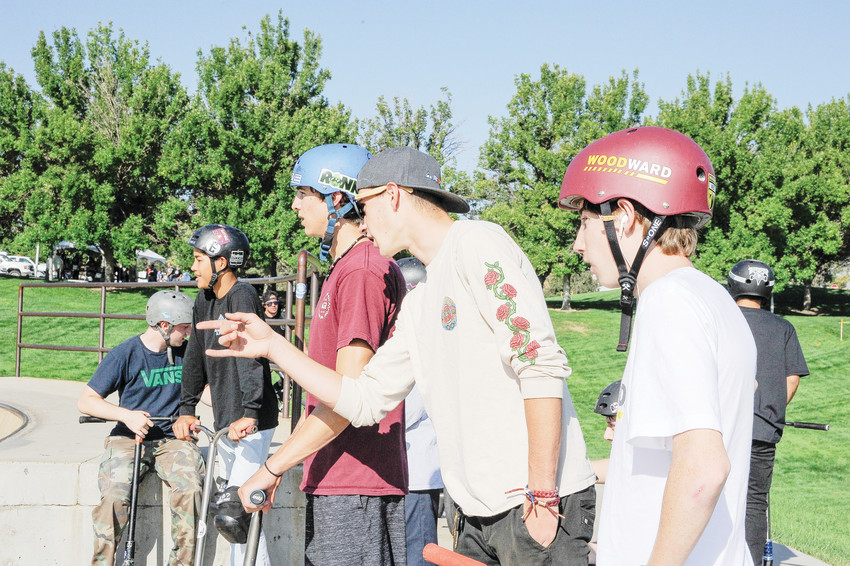 Ryan Battistella, 20, of Westminster, center, gives some inside information to skooter contestants, prior to the Skatepark Competition at this year's Thornton Harvest Fest Sept. 8, at Thornton Community Park. Battistella, a Thornton High graduate, missed the competition due to a recent concussion.