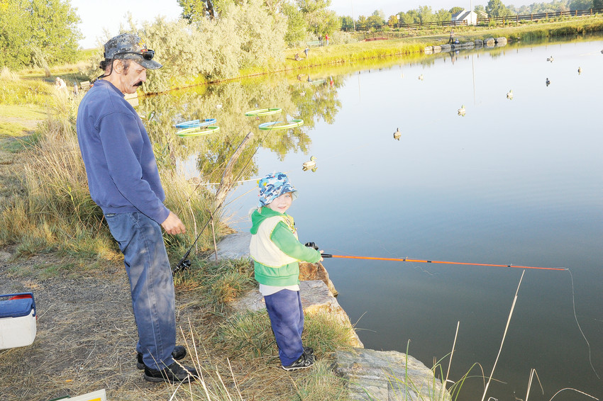 Keith Albright, of Northglenn, left, oversees his grandson, Jamison Stewart-Paine, during the Fishing Derby of Thornton Harvest Fest, Saturday Sept. 8, at Grandview Ponds.