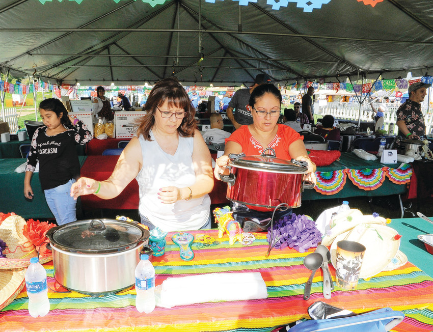 Bernadette Raes, right, of Aurora, and her mother Eva Tafoya, of Pueblo, get crockpots ready for their green chili entries, at this year's Marc Jr. Foundation Chili Cookoff, at Thornton's annual Harvest Fest Sept. 8.
