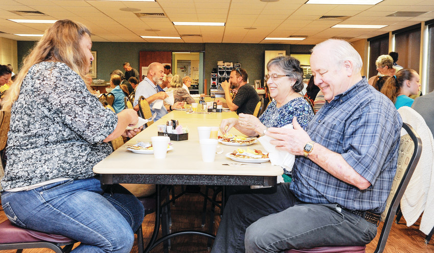 Natalie and Ron Lickteig of Westminster, right, get ready to enjoy a pancake breakfast with their daughter-in-law, Kimberley Lickteig, at the Thornton Active Adult Center, Sept. 8.