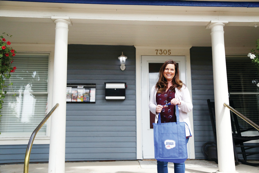 Tera McNellis, owner of Blue Door Welcoming Service, delivers welcome bags to new residents in Arvada.