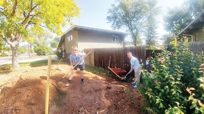 A couple of volunteers do yard work in Arvada during the annual Neighborhood Rehab Project's Be A Tool Day of Service on Sept. 8. This is the third year the event has taken place in Arvada and this year's 205 volunteers completed 12 projects.