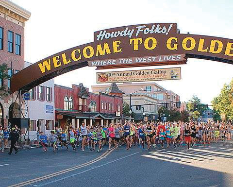 A large crowd races down Washington Avenue during 2015's Golden Gallop. The annual race is the Golden Schools Foundation's primary fundraiser.