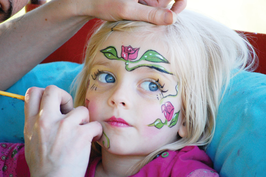 "A little girl gets her faced painted at the Morrison Ciderfest. The event is aimed to be ""economically friendly,"" according to Ryan Kloberdanz, chairman of the Morrison Ciderfest Committee."