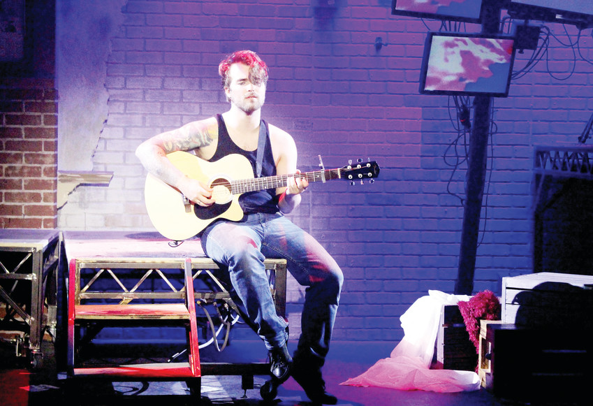 "Brian Robertson plays Johnny in the rock opera, ""Green Day's American Idiot,"" playing at Town Hall Arts Center in Littleton."