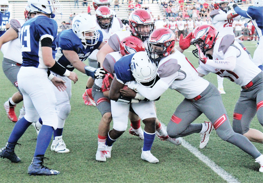 The Heritage Eagles flock together to make a tackle on Thornton running back Traekwon Scott-Roberts at Five Star Stadium Sept. 14.