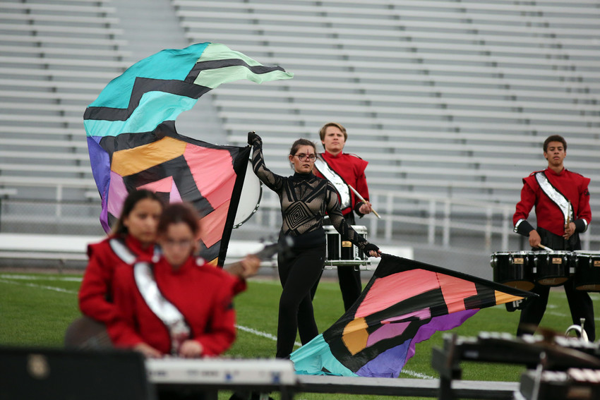 Casey Shade performs flags with the Arvada High marching band.