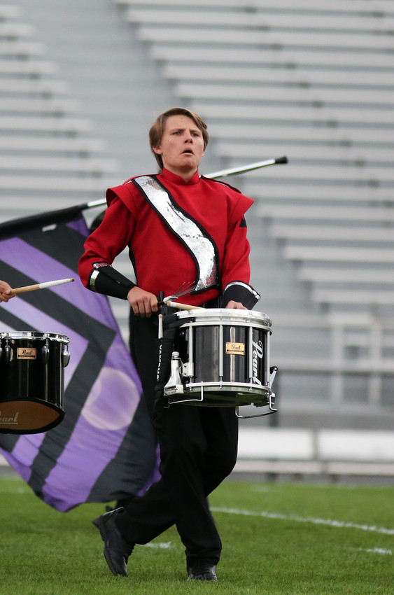Draeth Wagner plays the snare drum with the Arvada High marching band.