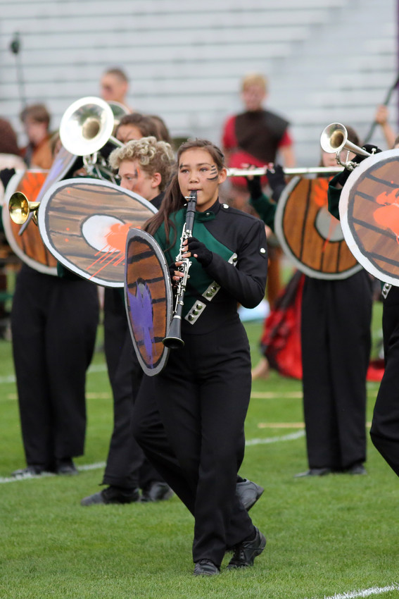 Clarinet Player Ada Graham marches with the D'Evelyn band.