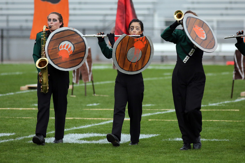 Kass Theobald and Grace Li march with the D'Evelyn band at the Jeffco Invitational.
