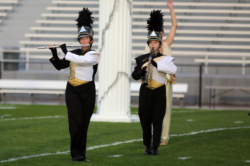 Anna Richards and Autumn Marquis march with the Green Mountain marching band Sept. 17.