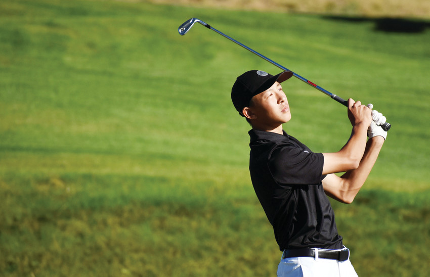 Lakewood sophomore Ryan Liao watches his drive during the boys golf Jeffco League tournament Sept. 13 at Fox Hollow Golf Course in Lakewood. Liao wrapped up the Class 5A Jeffco League individual medalist title with a round of 74.