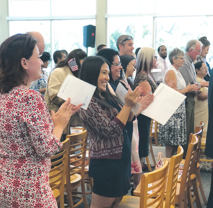Nearly 40 people from 17 countries celebrate their U.S. citizenship at a naturalization ceremony. The emotional event took place Sept. 15 at James H. LaRue Library in Highlands Ranch.