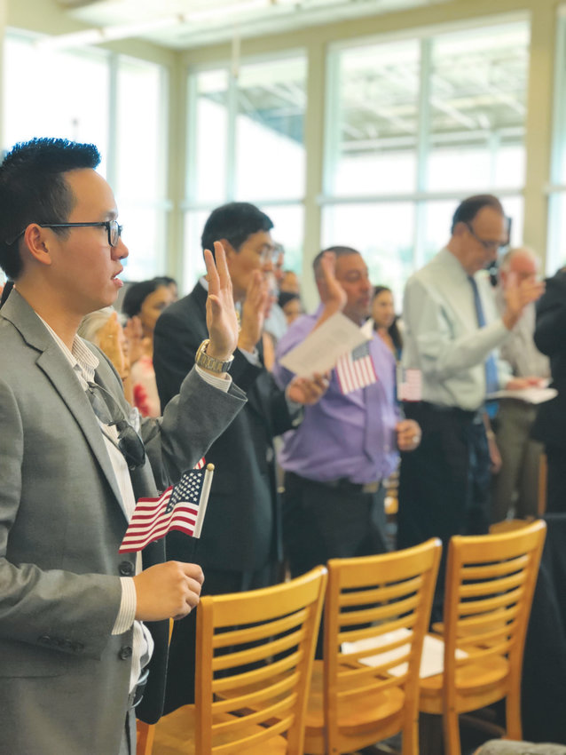Nearly 40 immigrants from 17 countries become U.S. citizens at a naturalization ceremony presented by the U.S. Citizenship and Immigration Services. Douglas County Libraries has hosted three of the ceremonies in the past two years.
