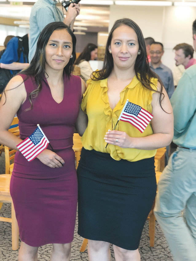 Guadalupe Montanez, left, and her older sister Marolina Montanez become U.S. citizens at a naturalization ceremony presented by the U.S. Citizenship and Immigration Services. Douglas County Libraries hosted the event on Sept. 15 at its Highlands Ranch library.