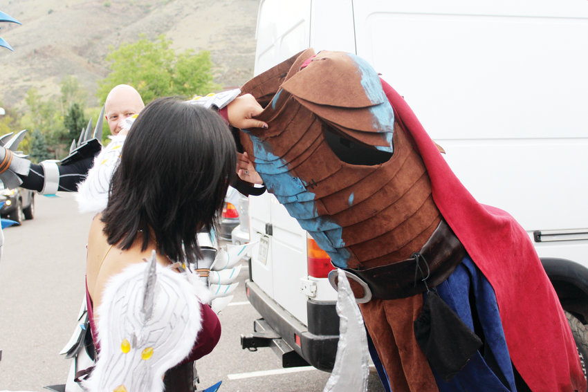 Elena Mathys helps Jennifer Losty take off the torso part of her Valka costume Sept. 16 at Lions Park in Golden.