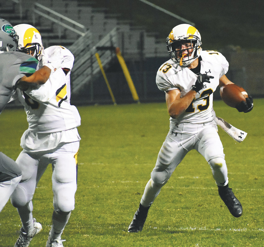 Green Mountain junior Trey Corkin (13) looks for running room Sept. 21 at the North Area Athletic Complex. The Rams mounted a second-half comeback to defeat Standley Lake 31-19.