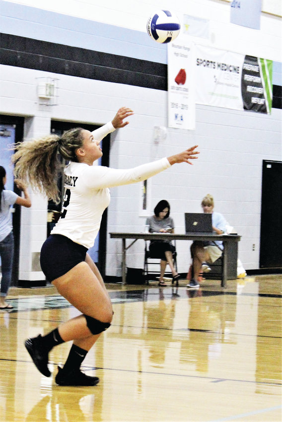 Legacy senior Emma Quarles serves the ball Sept. 18 at Mountain Range High School against the Lady Mustangs.