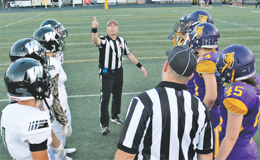 Westminster and Boulder captains take part in the opening coin flip Sept. 21 at Boulder High School.