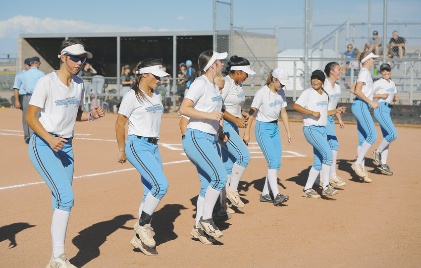 "Mountain Range softballers do the ""Cotton Eyed Joe"" before their Sept. 20 game against Monarch. The Lady Mustangs beat the Coyotes, 7-2."