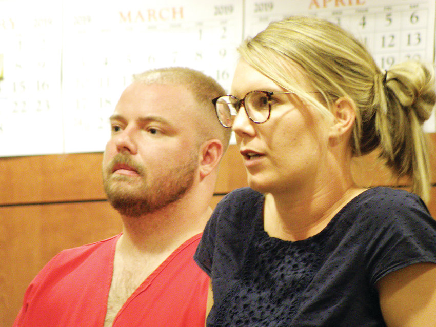 At a hearing in a Kiowa courtroom on Sept. 17, Daniel Pesch stands with public defender Elizabeth Orton, who is heading his defense against first-degree murder charges in the 2010 death of Kiowa High School teacher Randy Wilson.