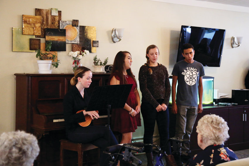 A group of students performed musical acts at Arbor View senior living in Arvada.