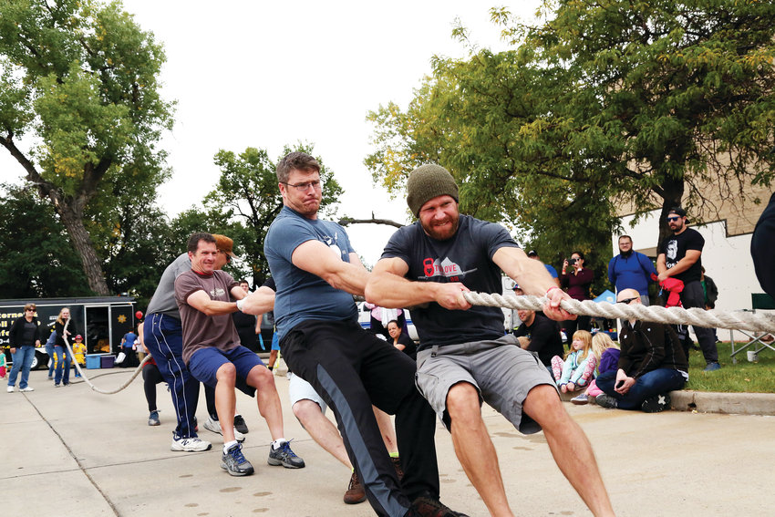 Members of Applewood Crossfit participate in the Fire Truck Pull fundraiser for Special Olympics.