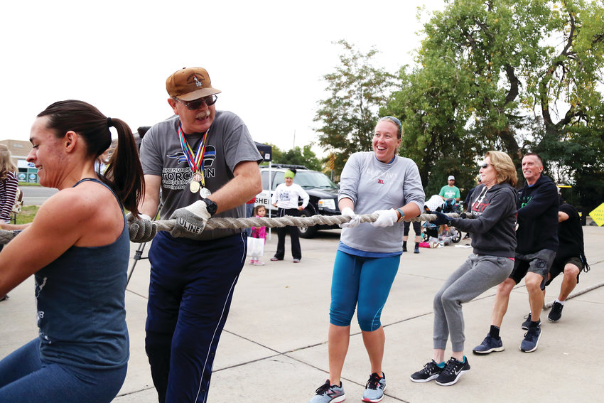 Special Olympics athletes David Dean and Amanda Baumann participate in the first truck pull of the day, Sept. 29.