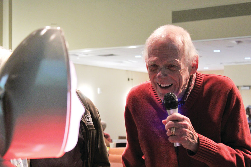 Harold Anderson asks Ryan, an artificial intelligence companion robot, to tell a joke at the Living and Aging Well Seminar at the Lone Tree Arts Center Sept. 29.