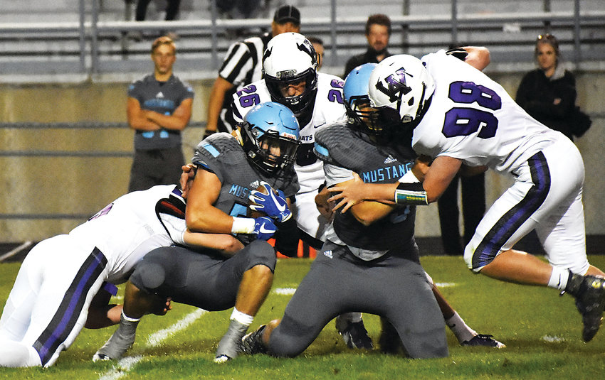 Ralston Valley senior running back Brad Roberts (5) fights for extra yards during the Mustangs' 42-13 victory over Arvada West on Sept. 27 at the North Area Athletic Complex. Ralston Valley has an all-time record of 9-0 against rival A-West on the football field.