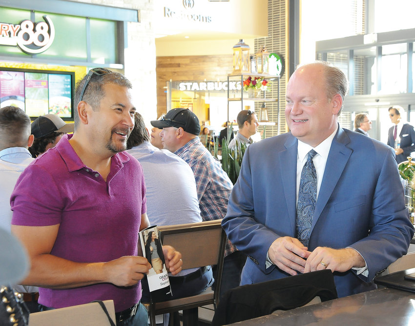 Greg Moss, president and CEO of Metro North Chamber of Commerce, right, visits with Vince Aragon, Thornton's sponsorship and marketing coordinator, at a VIP breakfast before the official Sept. 27 opening of the new Denver Premium Outlet mall in Thornton.