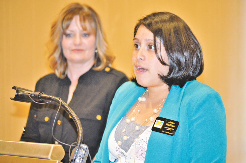 Northglenn City Councilor Julie Duran Mullica discusses the impact a proposed sales tax for transportation will have on her city as Thornton Mayor Heidi Williams listens during a Sept. 25 press conference at the Westminster Marriott Hotel.