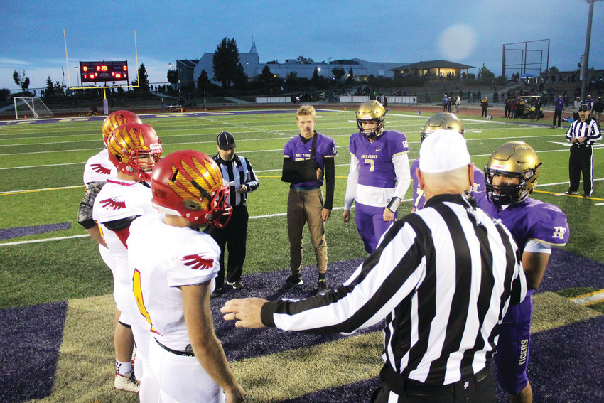 Captains for Skyline and Holy Family meet at midfield Sept. 28 at Holy Family High School. Holy Family outlasted Skyline 35-28 in a toe-to-toe battle that saw each team scoring back and forth in the first half.