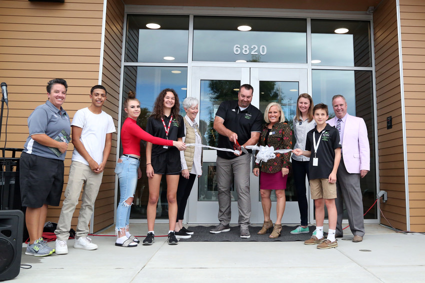 Apex board members are joined by local youth and Mayor Marc Williams for the official ribbon cutting of the new Apex Secrest Recreation Center.