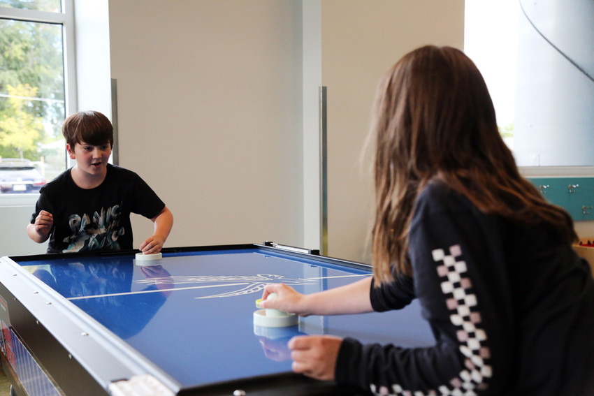 Holden Corning plays air hockey in the teen center portion of the new Secrest Recreation Center.