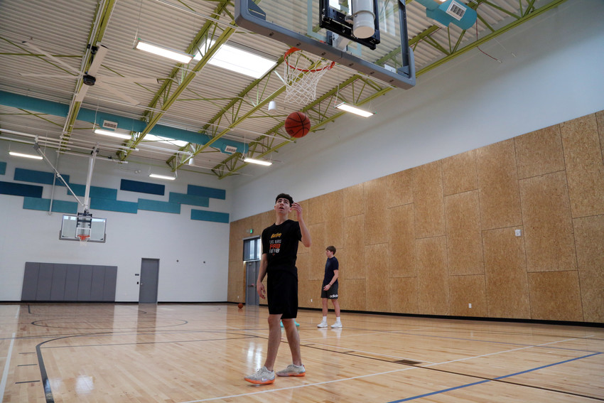 Colin Dean, 17, plays basketball in the new gym at the Secrest Recreation Center, which opened to the public Oct. 2.