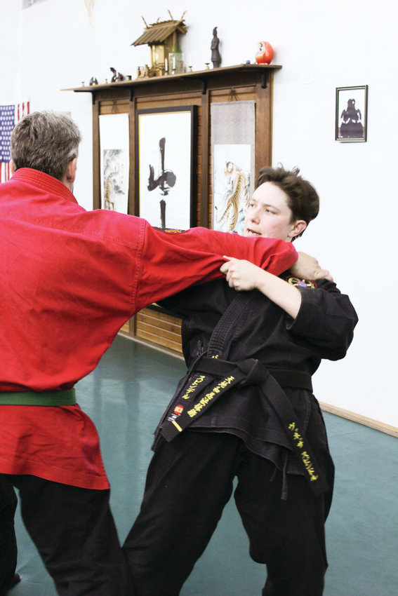 Vanessa Spindle, right, demonstrates a move on Steven Johnson at Wash Park Martial Arts. Spindle has been teaching martial arts for the last 15 years, and has been teaching self defense to women for the last three.