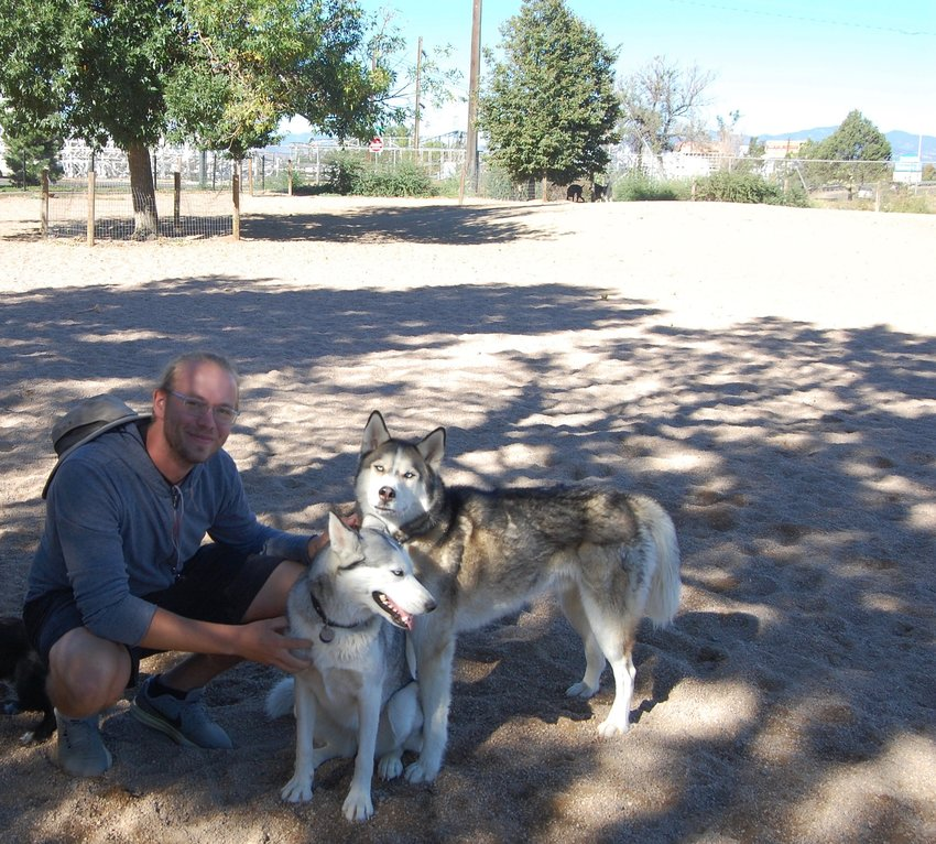 Brett Forsberg with his dogs, Dolly and Chewy, during their daily visit to Berkeley Dog Park.