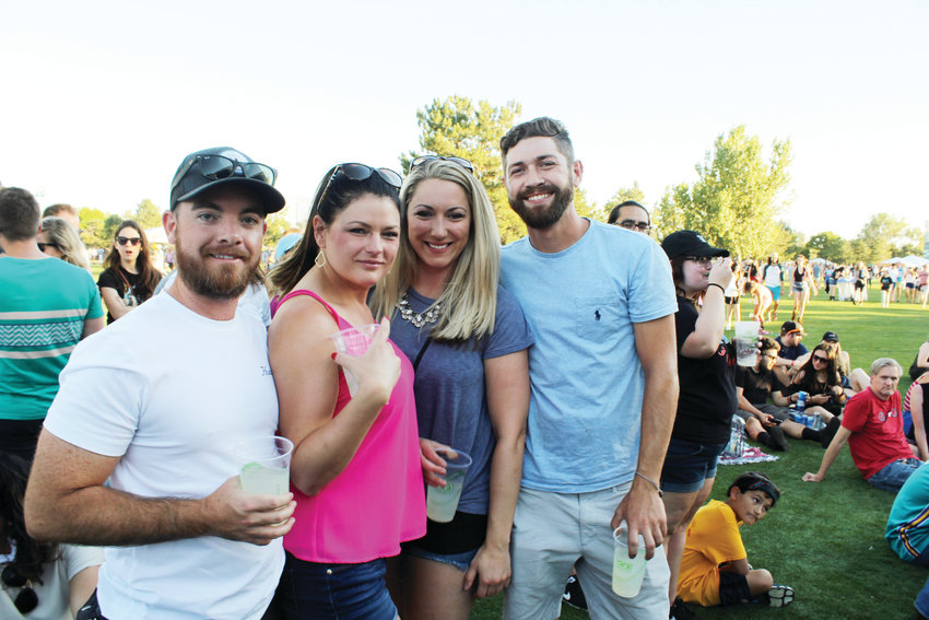 From left, Cody D'Angelo, Bridget D'Angelo, Lauren Van Sloten and Schuyler McHugh wait for Phoenix to play on Friday at the Grandoozy festival. The D'Angelos live in Platt Park and were happy to see Denver get its own music festival.