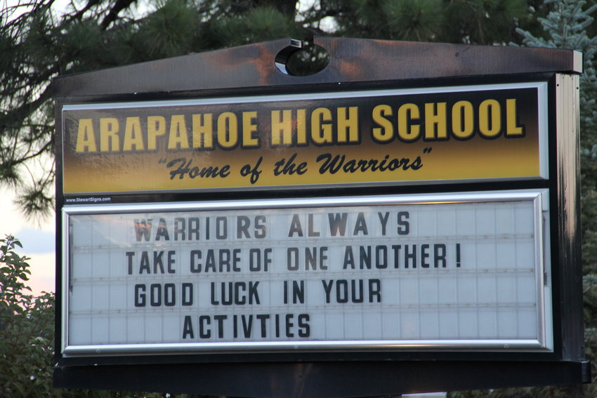 "The sign at Arapahoe High School in Centennial reads, ""Warriors always take care of one another! Good luck in your activities,"" on Oct. 4. Two Arapahoe students died by suicide within just days of each other, the school announced in letters to parents."
