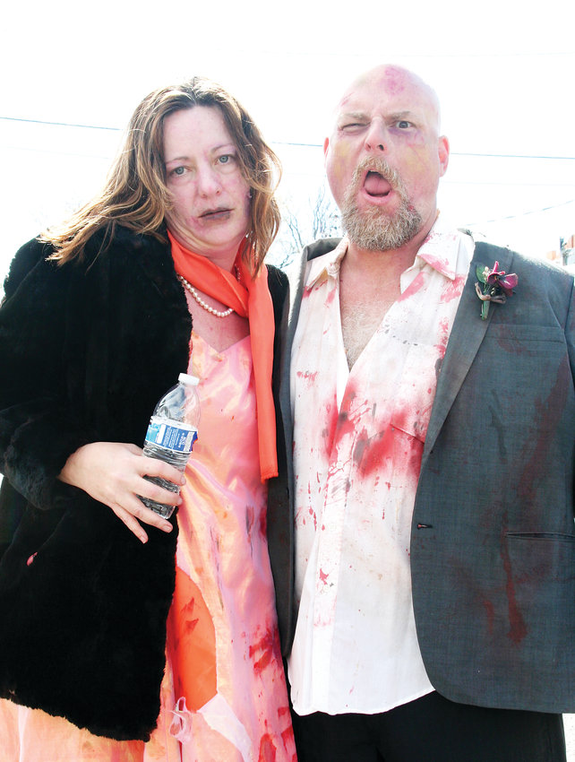 This was the first year for Denver residents Amy and Chris Carroll to participate in the Littleton Zombie Crawl and Pig Roast, but the two have been longtime customers of Reinke Brothers costume shop.