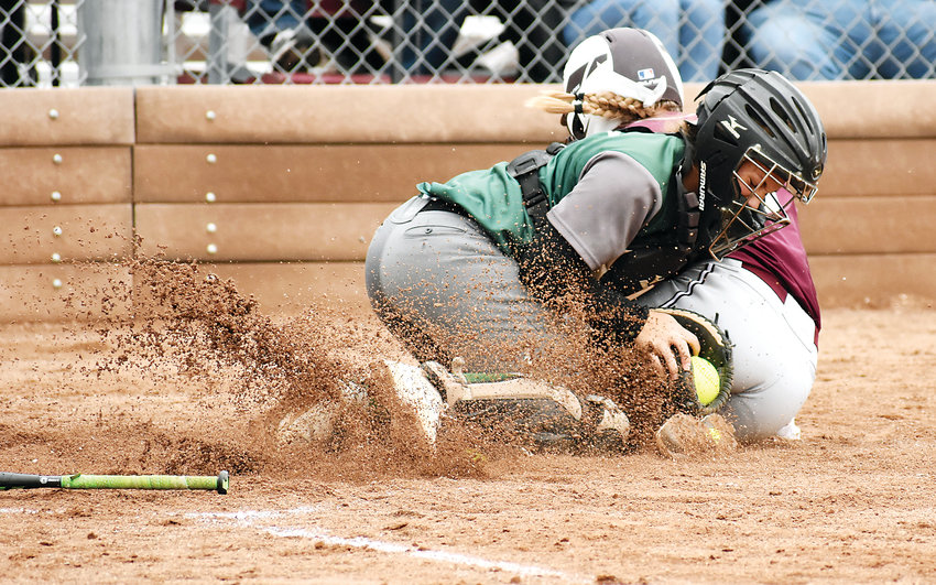D'Evelyn junior catcher Peyton Balbin is able to hang onto the ball during a collision at home plate with Golden junior Makayla Middleton during the second inning Oct. 6 at Golden High School. The Demons won 17-1 in four innings to complete a 10-0 record in Class 4A Jeffco this season.