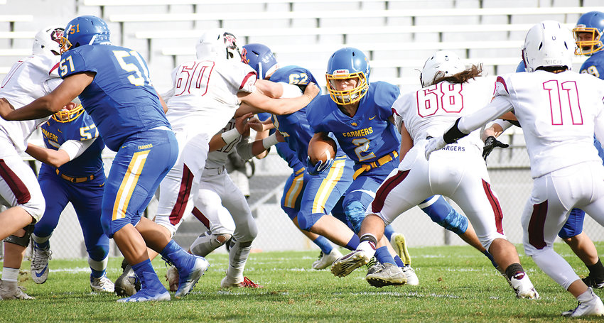 Wheat Ridge sophomore Rocco Tate (2) attempts to weave through Chatfield's defense in the first half Oct. 5 at Jeffco Stadium. Tate had a 75-yard touchdown run, but it wasn't enough as the Chargers scored in the final minute to take a 29-28 victory.