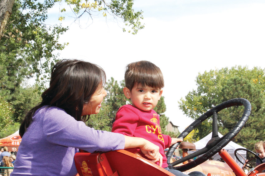 Katie Hui and Henry Craven enjoy a crisp, fall day at Cider Days.